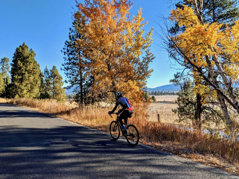A bicyclist explores Cabarton Road along one of four new adventure-biking routes that use Cascade, Idaho, as a hub. (Photo courtesy of the West Central Mountains Economic Development Council)